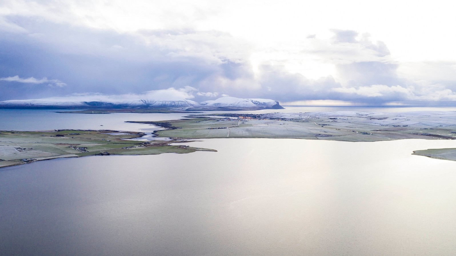 View over the Stenness Loch towards Stromness and Hoy - image by Andras Farkas