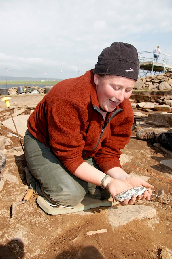 Archaeology student with a polished stone axe - image by Hugo Anderson-Whymark