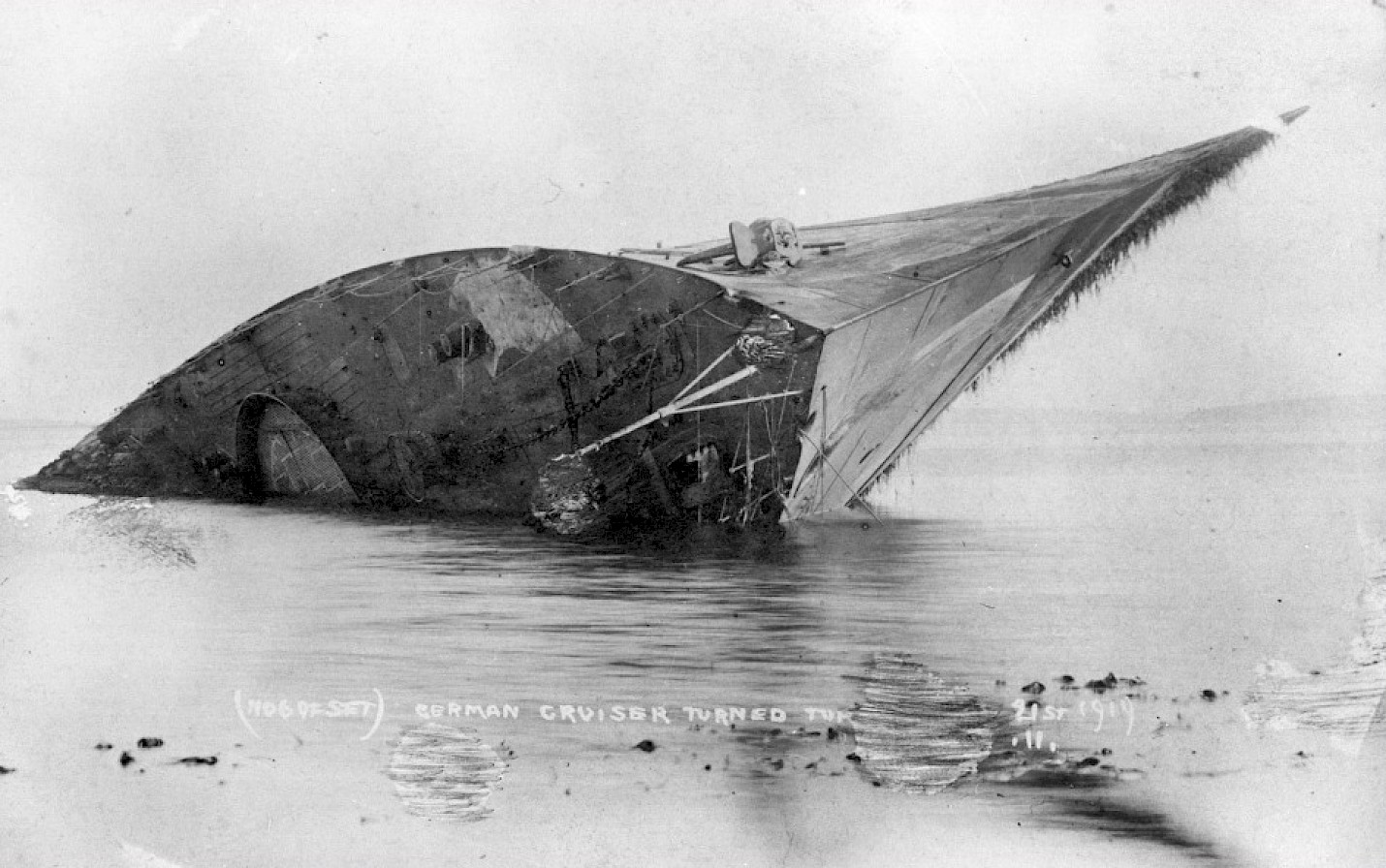 The light cruiser Bremse turned turtle in Scapa Flow - image courtesy Orkney Library & Archive