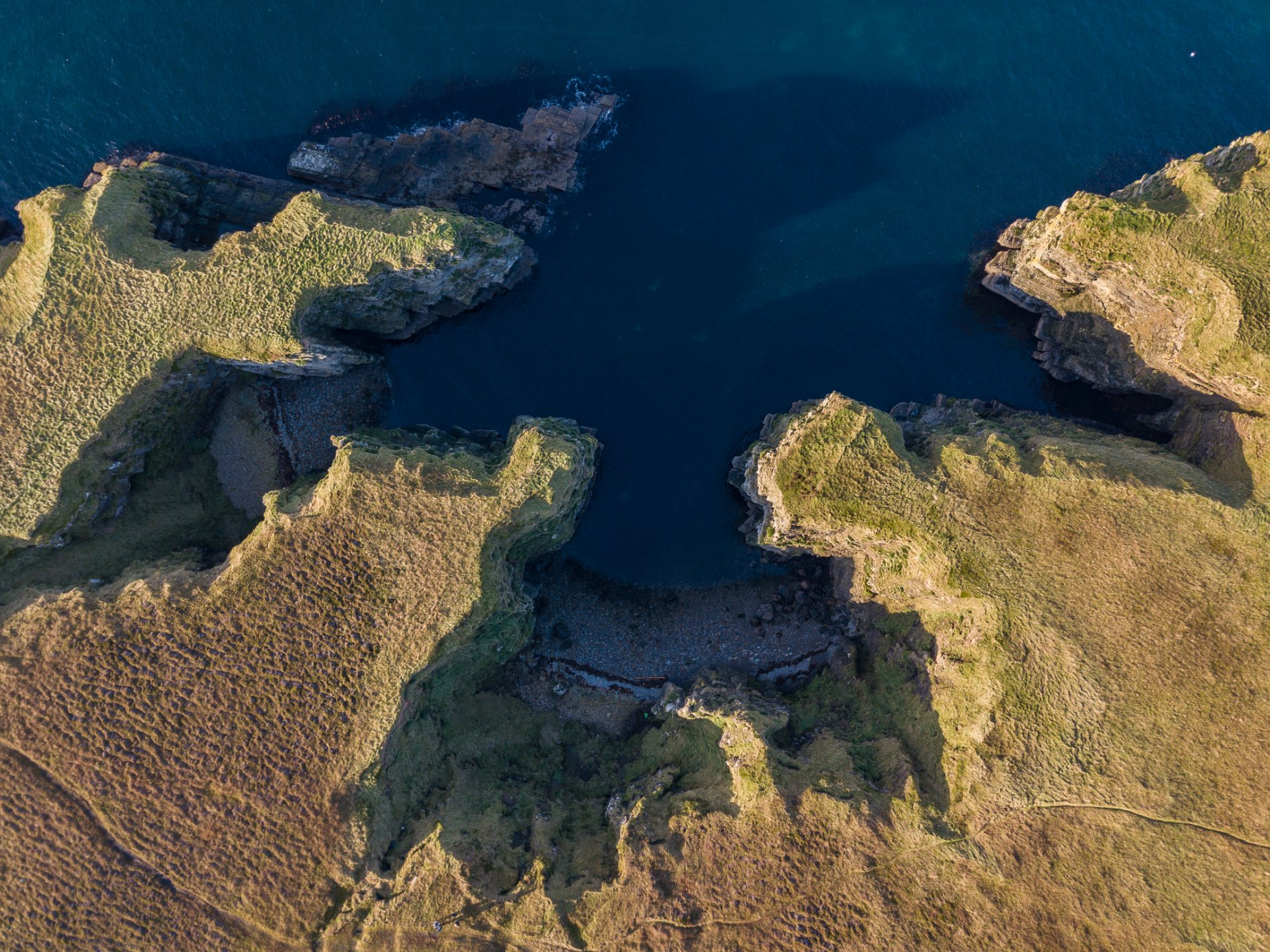 Craggy coastline in Deerness, Orkney - image by Akmal Hakim