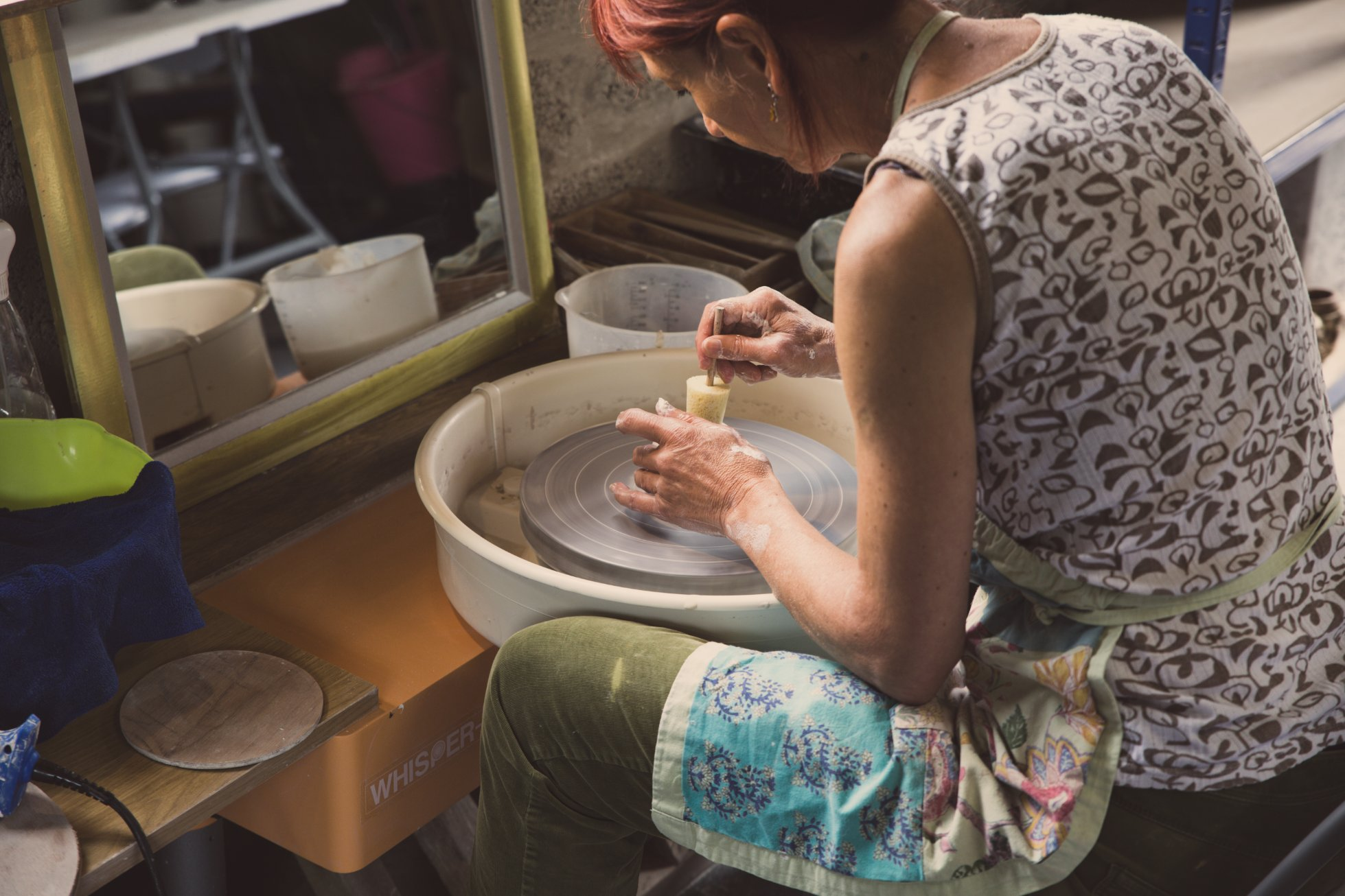 Elaine at her potter's wheel