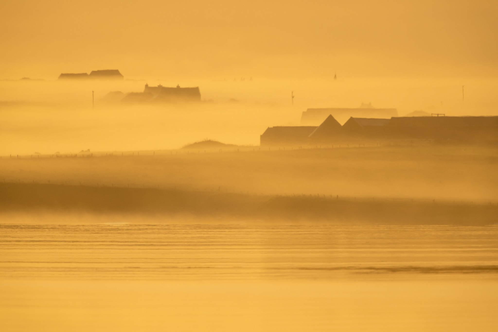 Misty morning in Orkney - image by Raymond Besant
