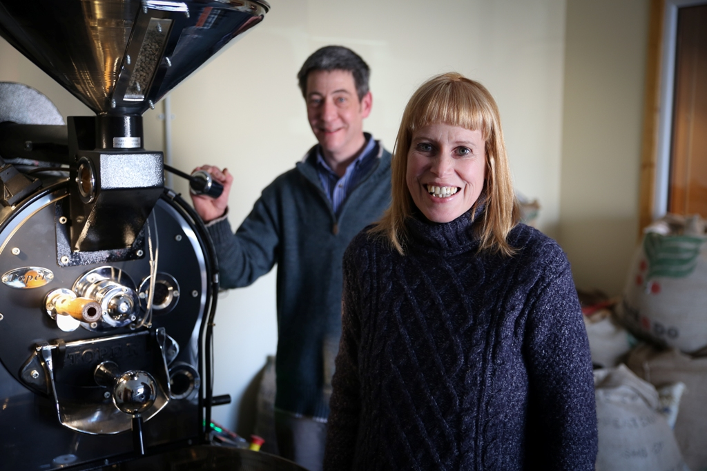 Euan Smith and Sara Tait from the Orkney Roastery, alongside their Toper roaster