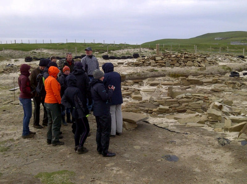 A tour group on site at the Links of Noltland in Westray