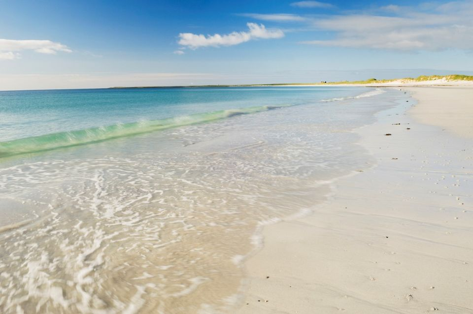 Blue water and golden sand in the Orkney island of Sanday
