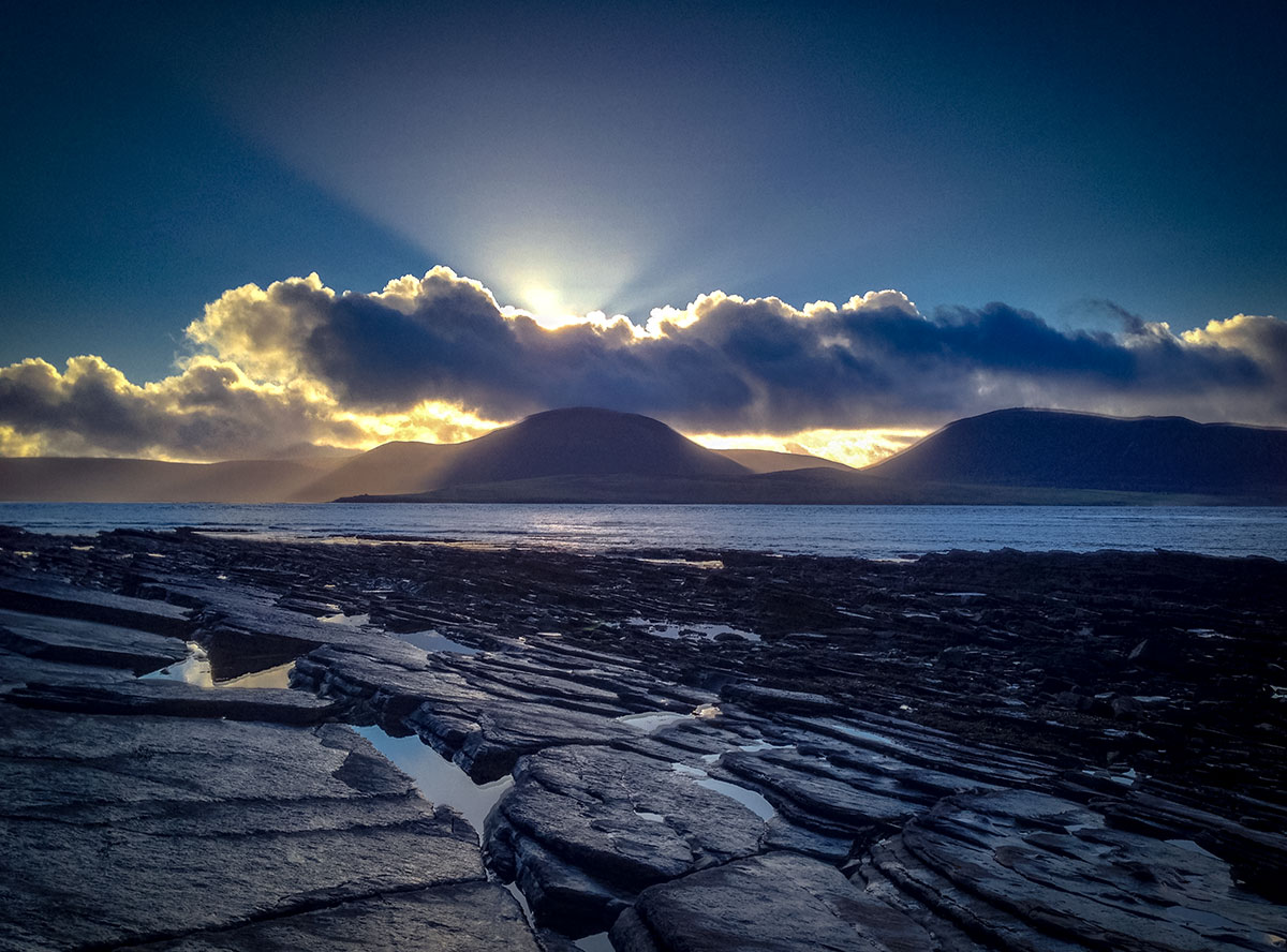Winter sun over the Hoy Hills - image by Sigurd Towrie