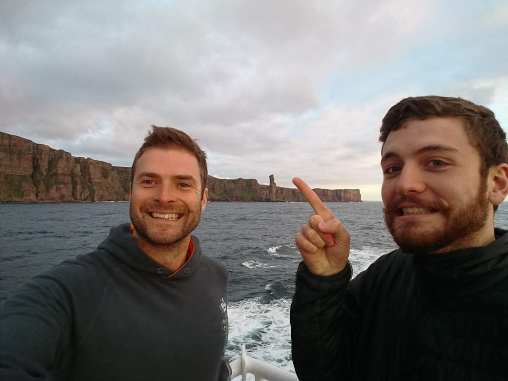 Pete Colledge and Alex Hale onboard the Hamnavoe, and their first sighting of the Old Man of Hoy - image by Pete Colledge