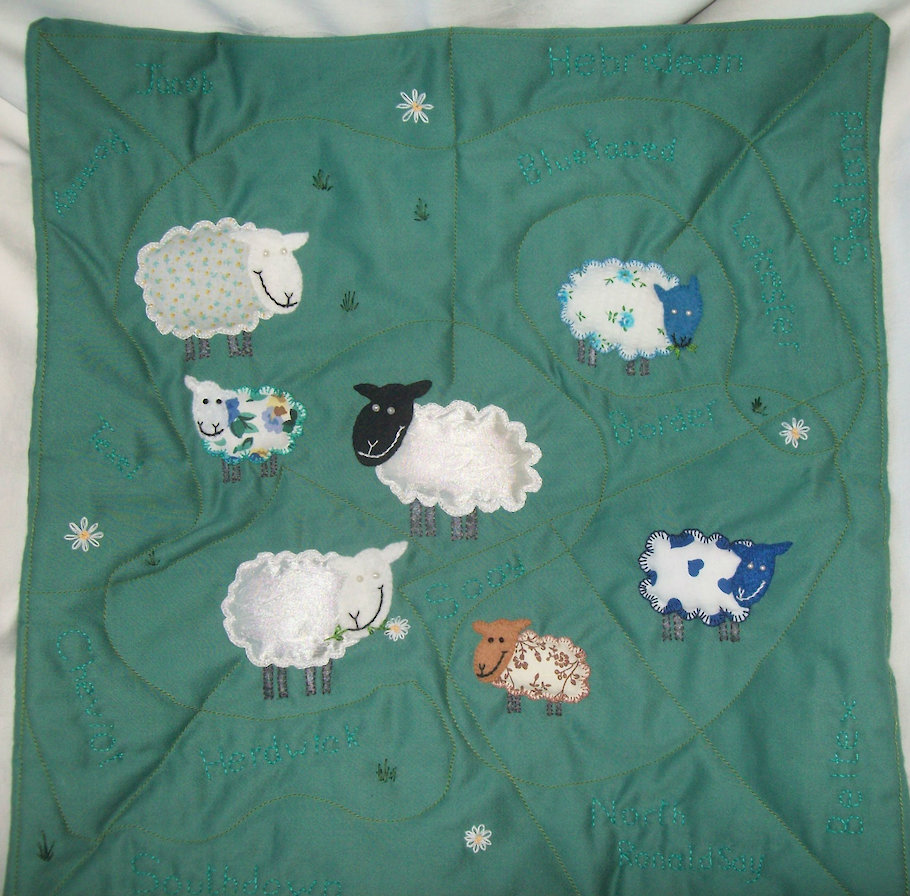 Quilted, applique and embroidered cushion 'Counting Sheep'.