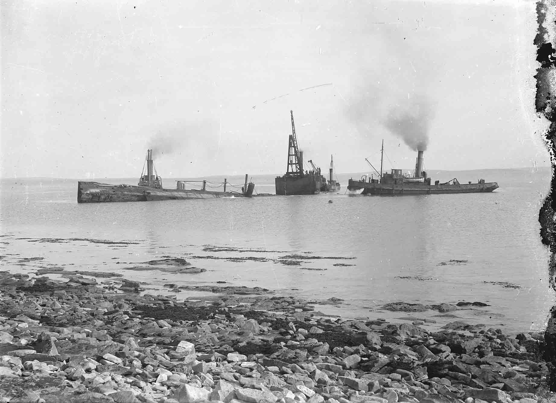 The subsequent salvage of the ships was an incredible feat of engineering - image courtesy of the Orkney Library and Archive