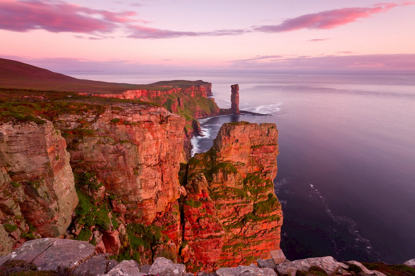 Maybe it's the iconic landmarks, like the Old Man of Hoy?